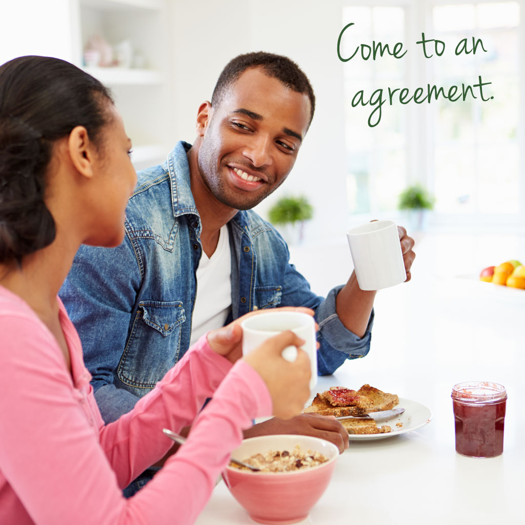 Man and woman having breakfast and talking with text saying come to an agreement