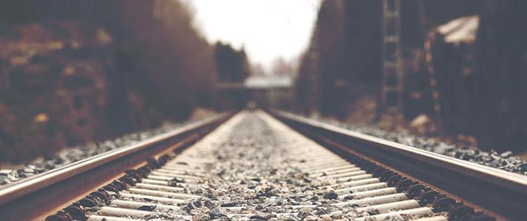 Photo of empty railroad tracks during the day