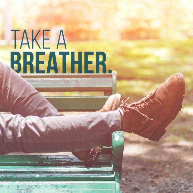 "Feet and legs of someone lying on a bench with text saying ""take a breather"""