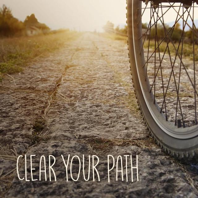 "Picture of bike riding along a path with text saying ""clear your path"""