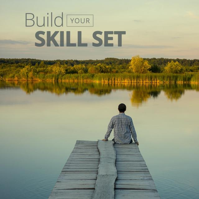 "Man sitting on dock looking at lake with text saying ""build your skill set"""