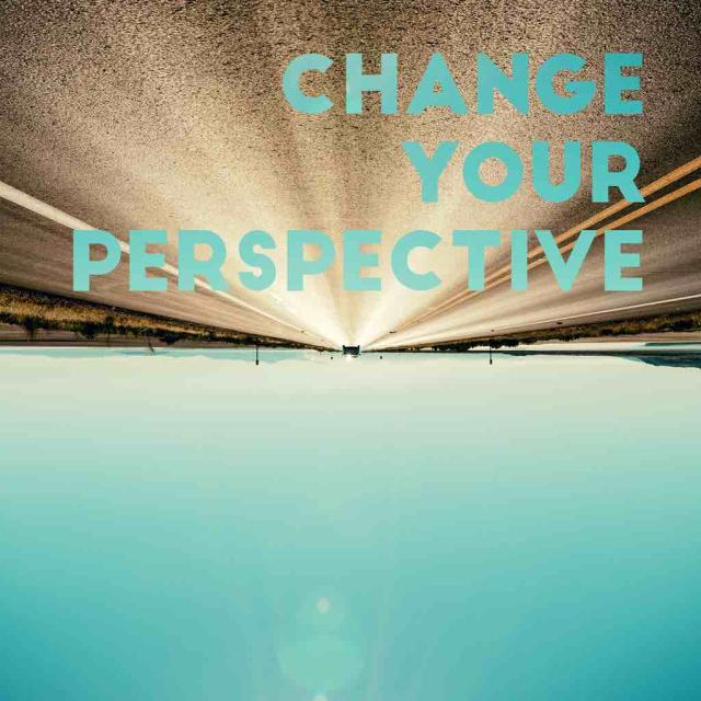 upside down image of horizon in the distance with text stating change your perspective